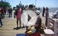 Burmese Pythons around tourists necks at Santa Monica Pier