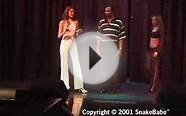 Snake charm, comedy magician pulls a python from your pants!